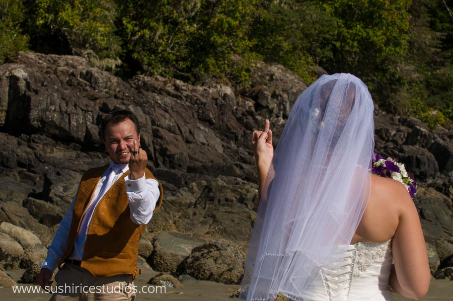 Groom giving his bride the finger