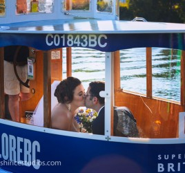 bride and groom in water taxi