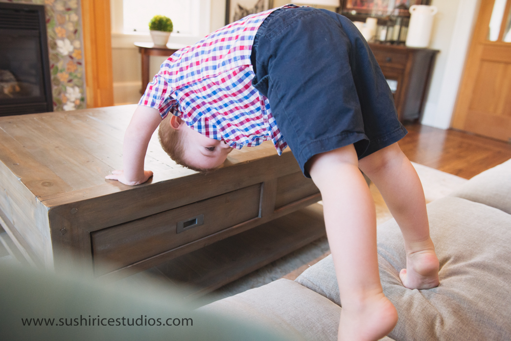 Boy climbing on furniture