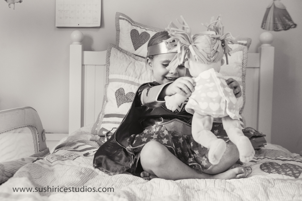 Little girl playing with doll