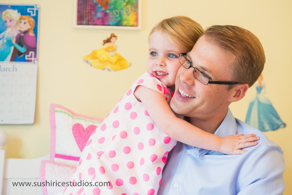 Hugs for daddy from little girl