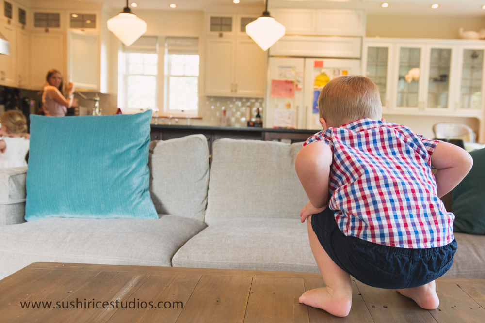 Toddler climbing on coffee table