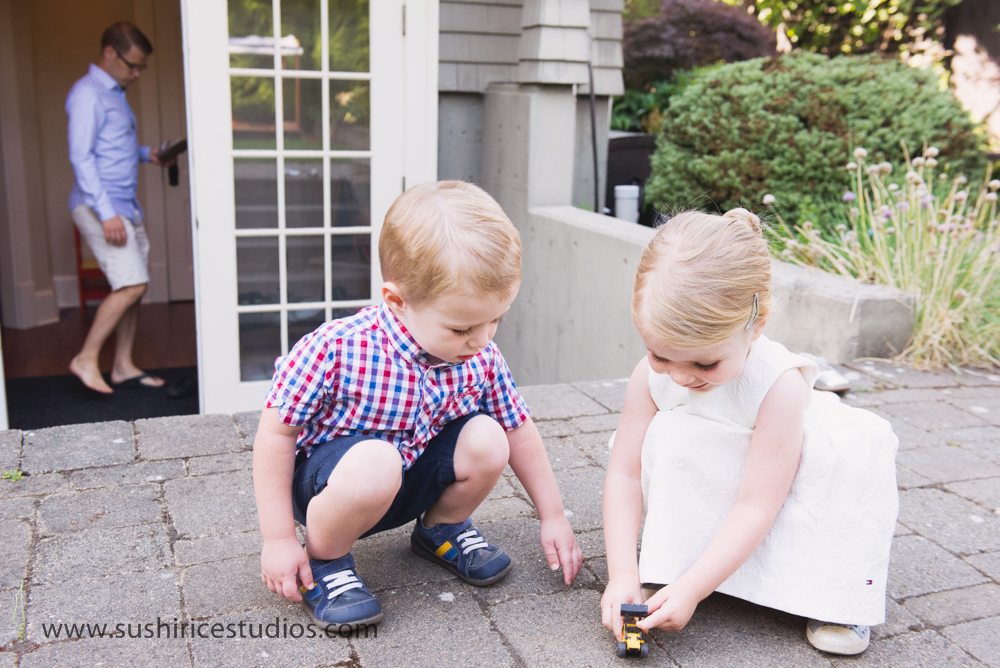 Siblings playing with small toy