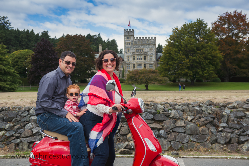 Family on Scooter in front of Hatley Castle
