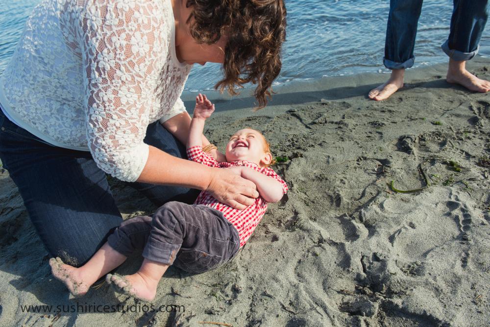 Mom tickling toddler
