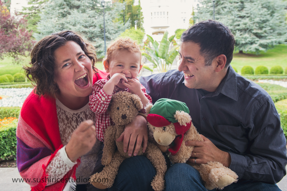 Family laughing with teddy bears