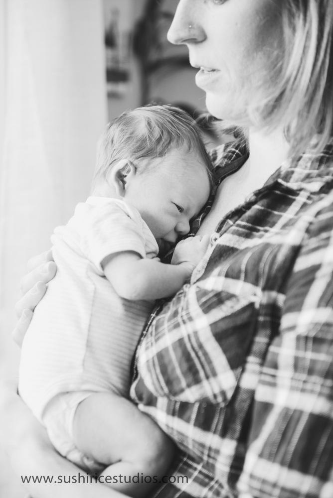 Newborn snuggling mom